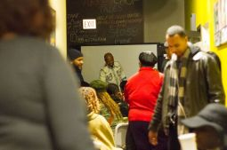 Quentin Love, right, with supporters during a Dec. 15 watch party at his Turkey Chop Gourmet Grill, the West Side restaurant he owns. Love, who won the competition, donated his proceeds to the soup kitchen the restaurant operates. | Stacey Rupolo/Contributor.