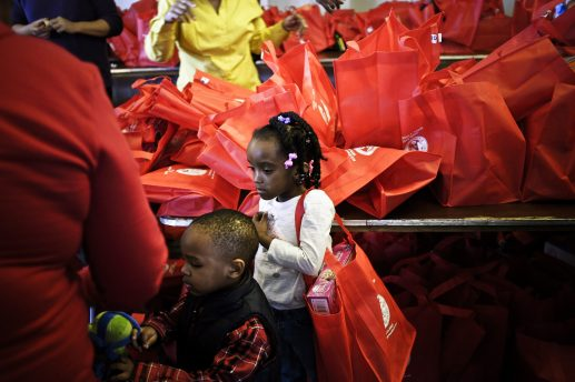 Children receive early Christmas gifts, and doses of hoiliday cheer, during a Dec. 19 Christmas toy giveaway hosted by Ald. Jason Ervin (28th), Cinespace Film Studios and Isiah  Thomas's Isiah International. The event was held at Cinespace Studios in North Lawndale.