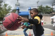 Pierre Stewart, 6, shows his dribbling skills during the grand opening of Moving Everest Charter school in Austin on Aug. 20. | WILLIAM CAMARGO/Staff Photographer