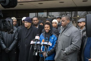 Evan Wimberly, flanked by clergy members and activists, during a Dec. 30 press conference outside of the 11th District police station on the West Side. | James Schumer/Contributor.