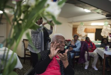 Le'Etter Bryant at her 103rd birthday party on Jan. 15 at an East Garfield Park assisted living facility. Her surrogate daughter, Dorothy Richardson, takes a picture behind her. Bryant is the facility's oldes resident. | William Camargo/Staff
