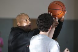 Coach James Foster, 59, facilitates a skills practice at Oak Park and River Forest High School on Feb. 13. Foster says his program, IMPACT basketball, focuses on developing the whole player.