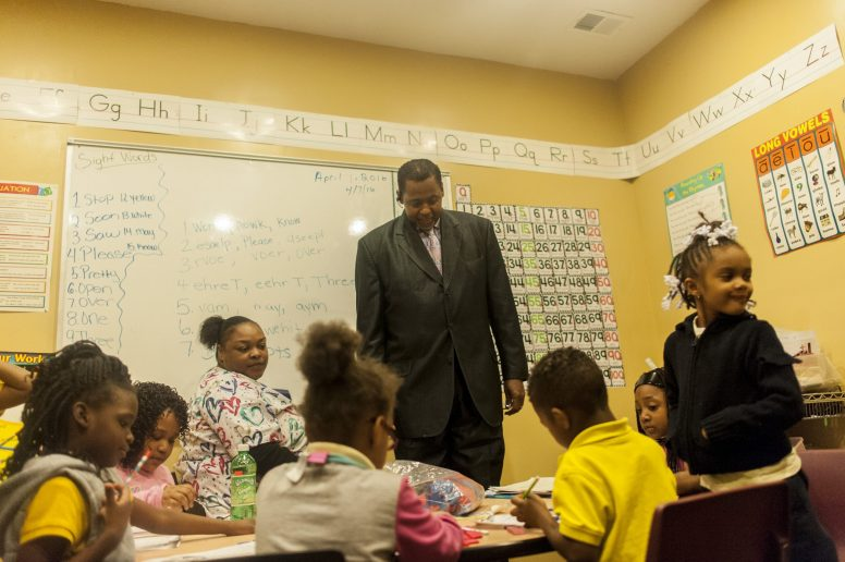 Rev. Joseph Kyles looks in on a daycare classroom inside his Austin church on April 7. | William Camargo/Staff