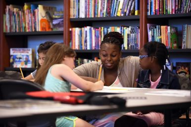 Students get some one-on-one time with a Dominican University graduate student during the college's School of Education Reading Academy Program. | Courtesy Dominican University
