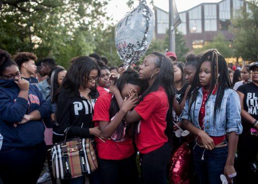 Sims' close friends during the Oak Park vigil. | William Camargo/Staff