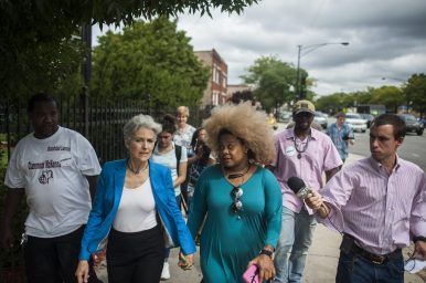 Green Party presidential candidate Jill Stein, second from left, walks with party organizer Zerlina Smith during a tour in Austin last week. | William Camargo/Staff