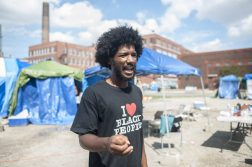 Damon Williams, 23, outside of the Freedom Square protest encampment he helped organize before it closed down last month. | William Camargo/Staff