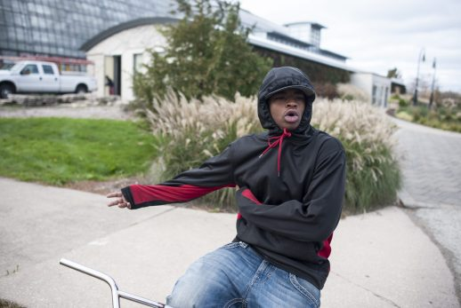 """Lavonte Walton, 18, expresses his ndisapproval of Trump's election last Friday afternoon. Walton called Trump """"a white gangster."""" 