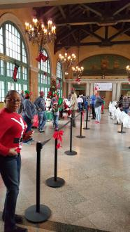 On Saturday, the Columbus Park Refectory, 5701 W. Jackson Blvd., was transformed into a hub of holiday delights, replete with multiple Santas, elves and tables teeming with gifts. Children enjoyed stuffed stockings and other delights. | Facebook