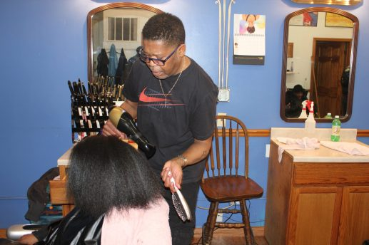 Vernell Davis, a veteran hairdresser, said he has seen and heard it all from his clients about their personal problems. | Wendell Hutson/Contributor
