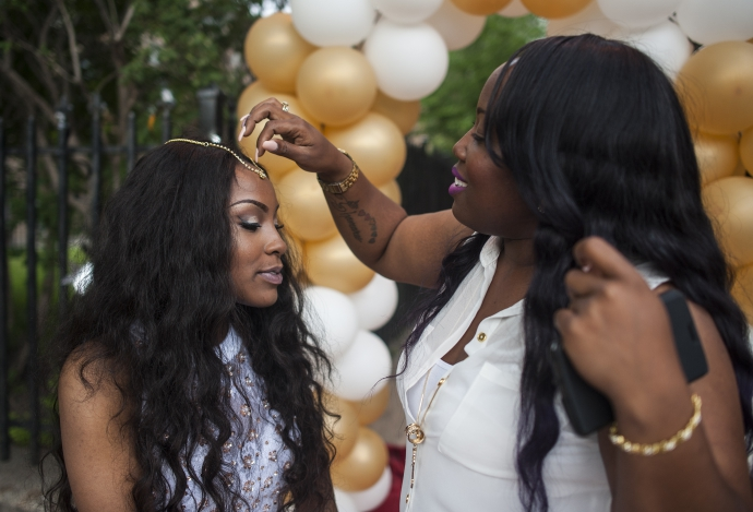 Kandyn Hatley, 18, gets glammed up before going to prom last year in Chicago's Austin neighborhood. This Sunday, the Proviso Township Glam Squad is giving away free prom dresses, suits, hair cuts, hair-styling sessions and nail tech sessions. | William Camargo/Staff