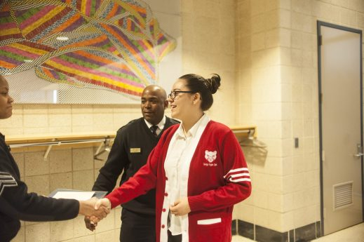 Julissa Soto shakes the hand of police officer as she is announced one of the winners of a Black History Month essay contest put on by Chicago Police Department on March 23, 2017.