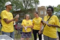 From left, Anthony Clark, Terri Svehla, Shelly Jamison and Sharita Galloway, all of Oak Park, gather on the corner on Wednesday, Aug. 30, during a remembrance celebration and barbecue for Elijah Sims at the corner of Lotus Avenue and Quincy Street in Chicago's Austin neighborhood. | ALEA ROGALS/Staff Photographer