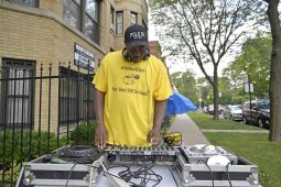 Cory Thomas, of Chicago, plays music on Wednesday, Aug. 30, during a remembrance celebration and barbecue for Elijah Sims at the corner of Lotus Avenue and Quincy Street in Chicago's Austin neighborhood. | ALEA ROGALS/Staff Photographer