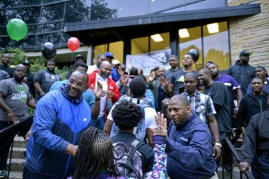High fives: Fathers cheer on students as they walk in on Wednesday, Sept. 13, 2017, before the start of the school day at Catalyst Circle Rock Charter School in Austin. | ALEXA ROGALS/Staff Photographer