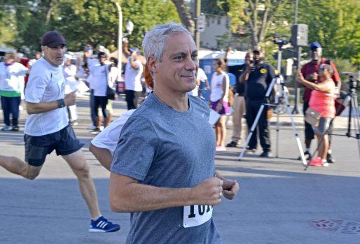 Chicago mayor Rahm Emanuel runs the course on Saturday, Sept. 23, during the annual Austin P.O.W.E.R. of Life 5K Walk/Run in Chicago's Austin neighborhood. | ALEXA ROGALS/Staff Photographer