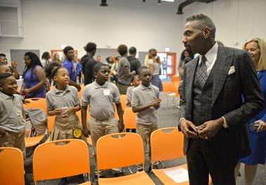 'Gifted and brown': Louis Carr, President of media sales at Black Entertainment Television (BET), greets students on Thursday, Sept. 28, 2017, during a back-to-school pep talk at By The Hand Club for Kids in Chicago's Austin neighborhood. | ALEXA ROGALS/Staff Photographer