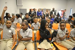 Children get ready for Louis Carr, President of Media Sales at Black Entertainment Television (BET), to speak on Thursday, Sept. 28, during a back-to-school pep talk at By The Hand Club for Kids in Chicago's Austin neighborhood. | ALEXA ROGALS/Staff Photographer