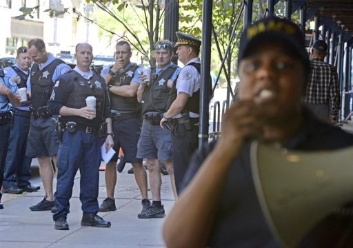 Chicago Police officers stand outside and mingle on Friday, Sept. 29, during a rally outside of Chicago City Hall on LaSalle Street in Chicago. | ALEXA ROGALS/Staff Photographer