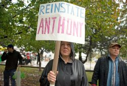 Participants hold up signs in the rain on Saturday, Oct. 14, during A Voice For All march outside of the Oak Park Farmers Market on Lake Street. | ALEXA ROGALS/Staff Photographer