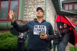 Aisha Coleman, of Oak Park, speaks to the participants on Saturday, Oct. 14, 2017, during A Voice For All march outside of the Oak Park Farmers Market on Lake Street. | ALEXA ROGALS/Staff Photographer
