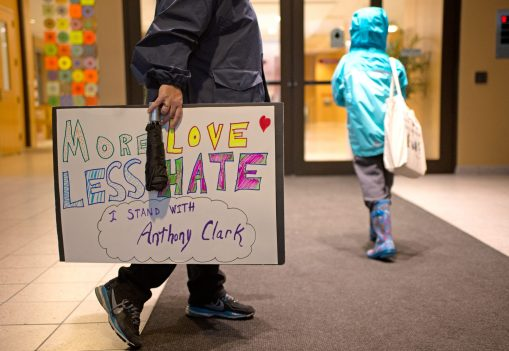 A sign in support of Anthony Clark is seen on Saturday, Oct. 14, during A Voice For All march at the Oak Park Public Library on Lake Street. | ALEXA ROGALS/Staff Photographer