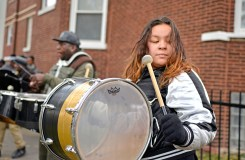 Members of the Exodus adult marching band group perform on Friday, Nov. 17, during a Good Neighbor Campaign rally on Massasoit Avenue near Augusta Street in Chicago's Austin neighborhood. | ALEXA ROGALS/Staff Photographer