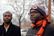 Organizer Brandon Johnson, right, speaks to attendees as State Representative Lashawn Ford listens last Monday, during a Black Workers Matter press conference outside on Arytza on Narragansett Avenue in Chicago's Galewood neighborhood. | ALEXA ROGALS/Staff Photographer