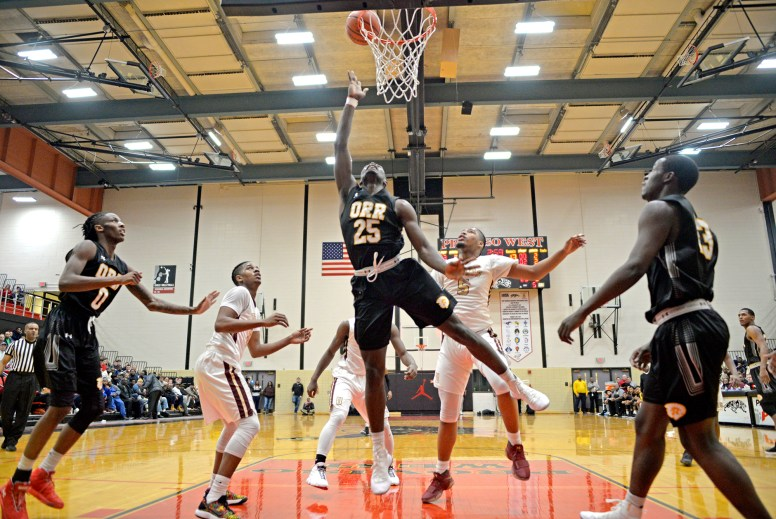 ON THE RISE: Orr's Raekwon Drake (25) goes up for a shot and scores on Friday, Dec. 29, 2017, during a game against Uplift at the 57th annual Proviso West Holiday Tournament at the school's campus in Hillside. | ALEXA ROGALS/Staff Photographer