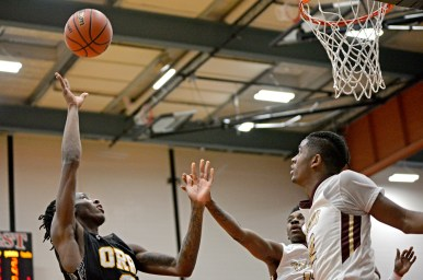 Orr's Tyronn Mosely (0) shoots the ball on Friday, during a game against Uplift at the 57th annual Proviso West Holiday Tournament at the school's campus in Hillside, Ill. | ALEXA ROGALS/Staff Photographer