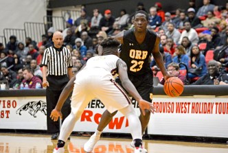 Orr's Dannie Smith (23) looks to pass to an open player on Friday, during a game against Uplift at the 57th annual Proviso West Holiday Tournament at the school's campus in Hillside. | ALEXA ROGALS/Staff Photographer