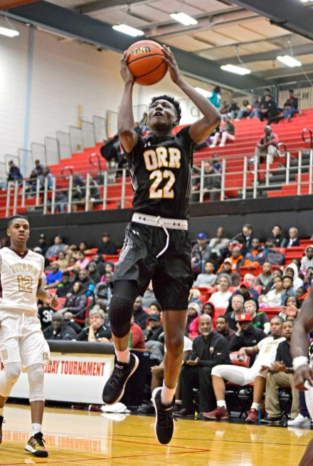 Orr's Tujautae Williams (22) jumps up for a shot on Friday, during a game against Uplift at the 57th annual Proviso West Holiday Tournament at the school's campus in Hillside. | ALEXA ROGALS/Staff Photographer