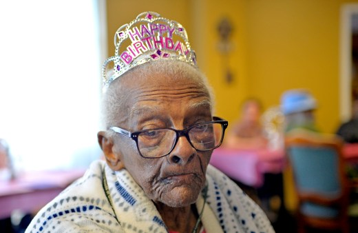 Le'Etter Bryant, of Chicago, listens to music last Wednesday, during her 105th birthday party at the Heritage Woods of Chicago. | ALEXA ROGALS/Staff Photographer