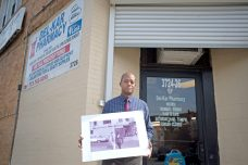 LESSON IN RESILIENCE: Edwin Muldrow stands outside of Del-Kar Pharmacy, 3726 W. 16th St. Del-Kar was one of the few stores that survived the riots following King's assassination on April 4, 1968. | ALEXA ROGALS/Staff Photographer