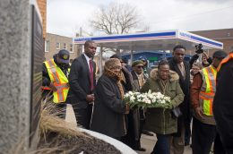 Attendees bring over a decorated wreath last Wednesday, during a wreath laying ceremony in remembrance of Dr. Martin Luther King, Jr. outside of the Austin Health Center on Cicero and Chicago Avenues. | Photo by ALEXA ROGALS/Staff Photographer