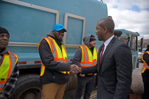 State Rep. La Shawn Ford, right, shakes hands with Streets and Sanitation workers last Wednesday, during a wreath laying ceremony in remembrance of Dr. Martin Luther King, Jr. outside of the Austin Health Center on Cicero and Chicago Avenues. | Photo by ALEXA ROGALS/Staff Photographer