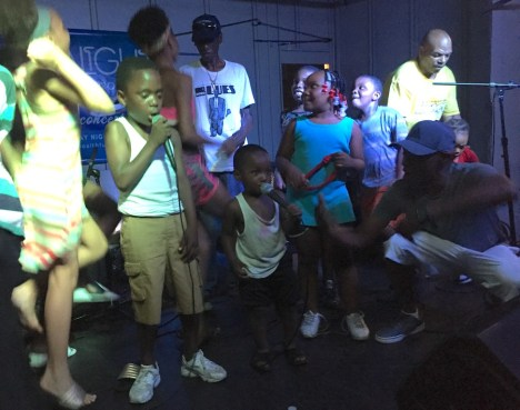 Youth join Larry Taylor on stage to rap some rhymes