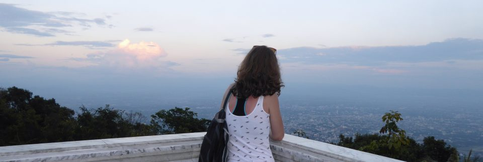 Photo of me watching the sunset in Chiang Mai, Thailand at the beginning of my first solo backpacking trip around South East Asia
