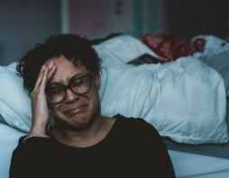 picture of black woman crying next to a bed - Claudia/Unsplash.com - AuthorPalessa.com