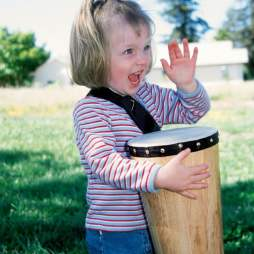Child with Autism Playing Conga Drum