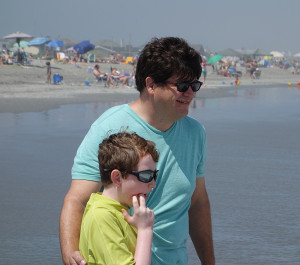 Autism Dad Rob Errera hits the beach with son, Rocco, in July 2013.