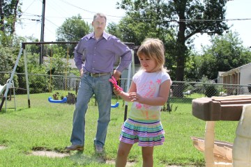 Michael Lockhoff plays with his daughter in their backyard in Tulsa.Nate Robson/Oklahoma Watch