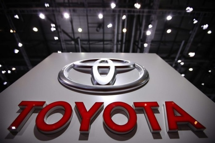 The Toyota logo is seen on the exhibition stand of Toyota during the 80th Geneva Car Show