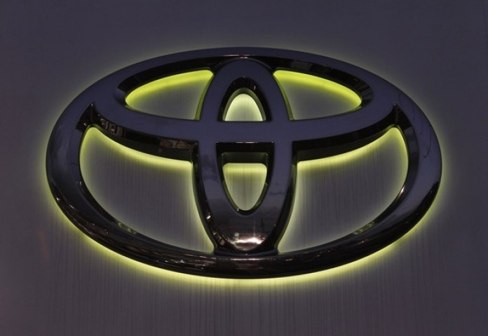 Toyota Motor Corp's logo is seen at a car dealer shop in Yokohama