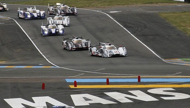 Lotterer of Germany leads the pack in his Audi R18 E-Tron Quattro Number 1 at start of the Le Mans 24-hour sportscar race in Le Mans