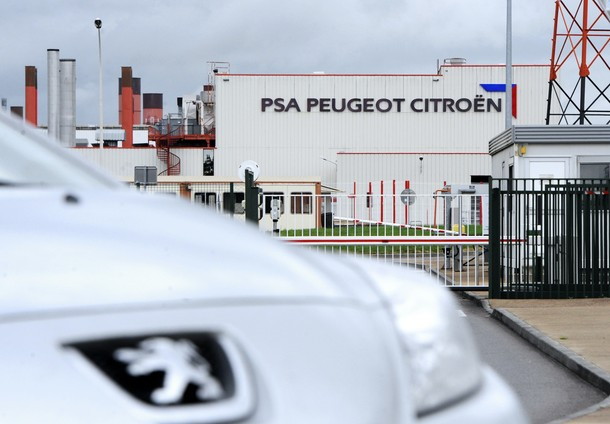 A Peugeot car is pictured in front of th