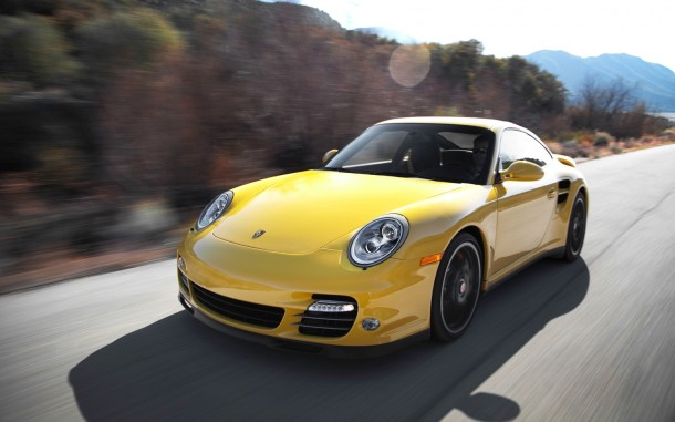 2012-Porsche-911-Turbo-S-front-three-quarters-in-motion-2