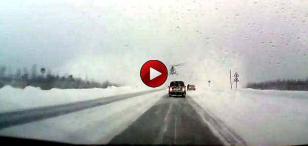 Helicopter Lands on Highway