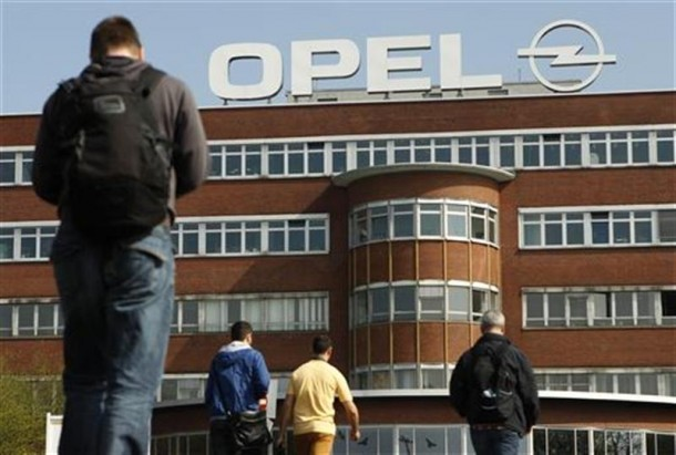 Workers arrive for their change of shift at the Opel plant of Bochum