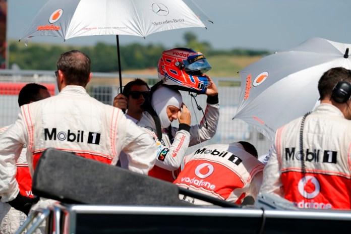 Jenson Button on the start grid